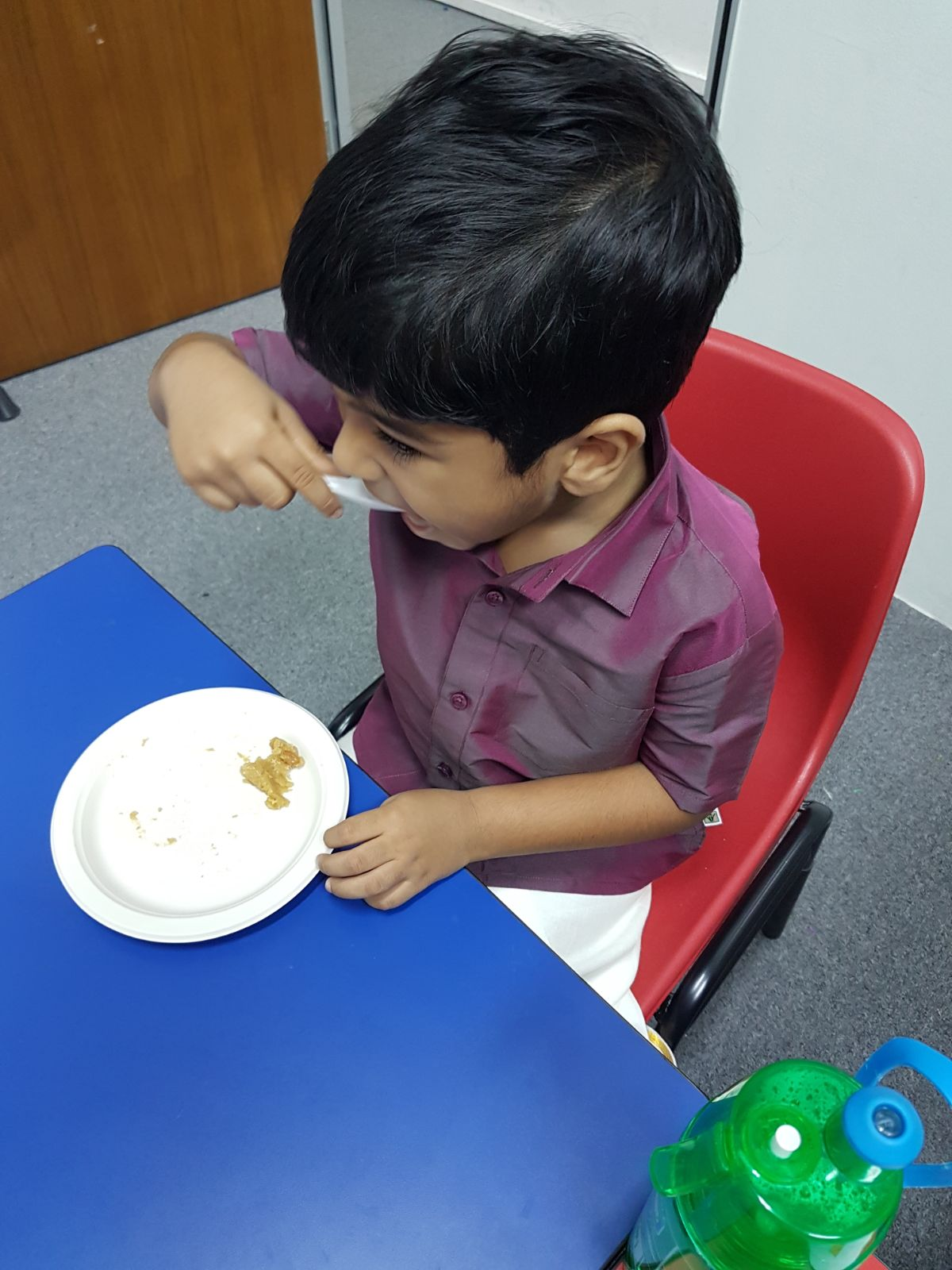 happily our student enjoying the Pongal sweet